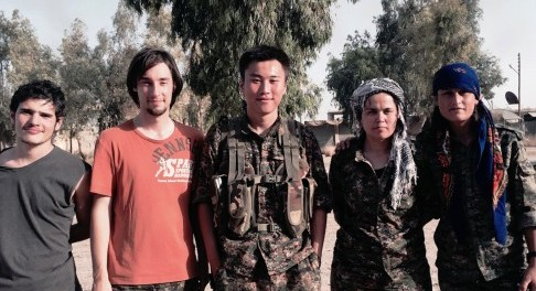 China-born volunteer Huang Lei, centre, pictured with fellow volunteers and Kurdish women fighters. Photo: Weibo