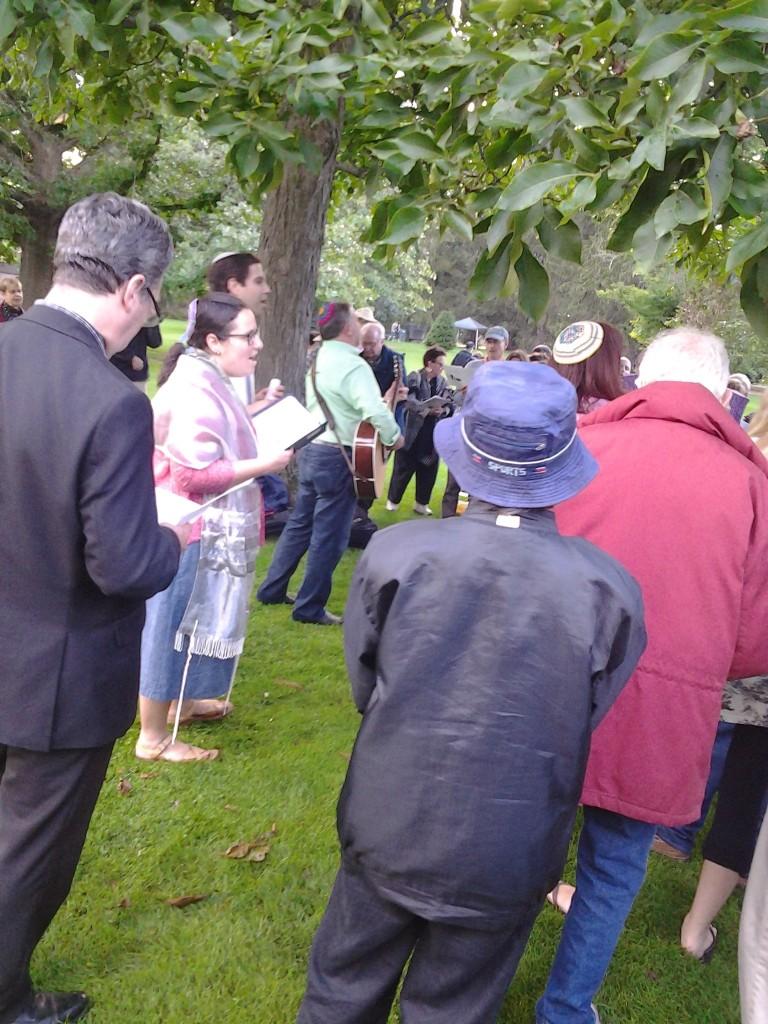 Photo credit: Penny Schwartz. Rabbi Jodie Gordon, foreground, with Rabbis Neil Hirsch and Rabbi Gary Gretton-Granatoor on guitar at Tanglewood.
