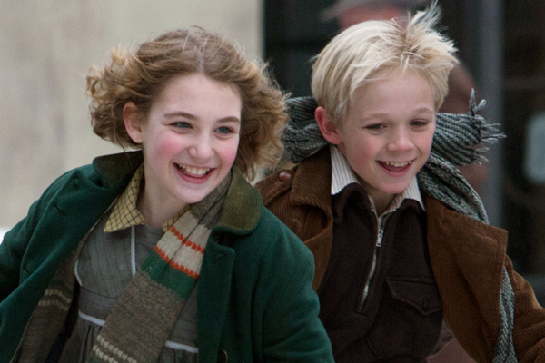 """This image released by 20th Century Fox shows Sophie Nélisse, left, and Nico Liersch in a scene from """"The Book Thief,"""" about a girl who loves books. (AP Photo/20th Century Fox, Jules Heath) ** Usable by LA and DC Only **"""