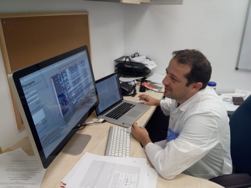 Dr Yuval Tabach in his lab: namely a computer and thousands of DNA data sets. (Credit: courtesy)