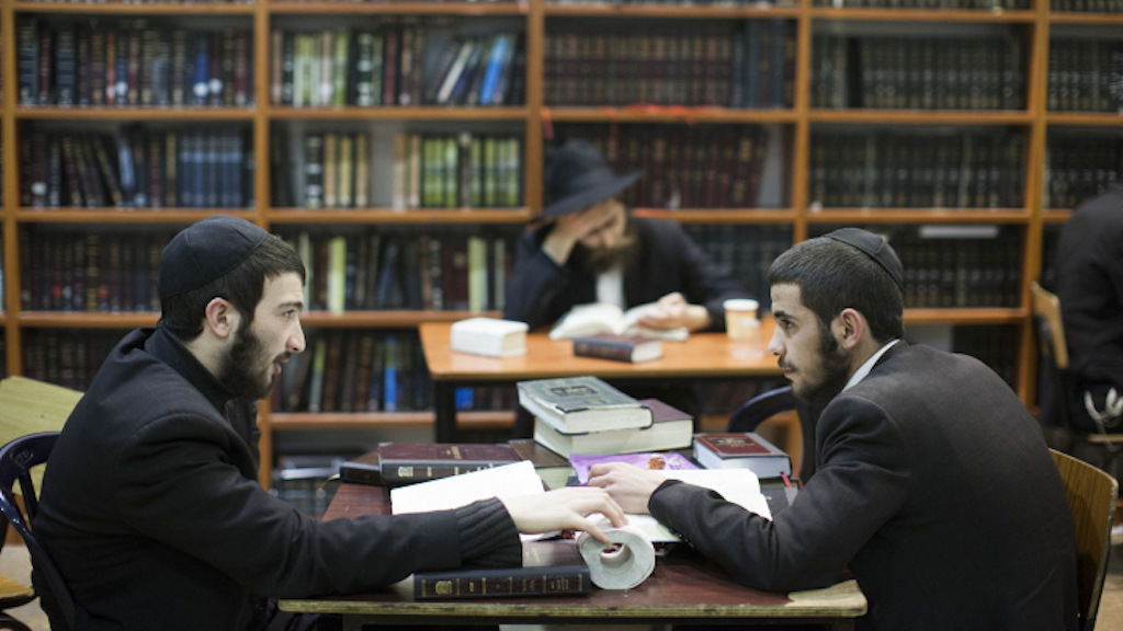 Ultra orthodox Jewish men studying at the Torat Emet Yeshivat in Jerusalem on February 4, 2014. Photo by Yonatan Sindel/Flash90