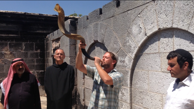 Mordechai Zeller (centre), alongside Father Matti, Sheikh Abu Adel (left) and Rabbi Drori (right), sounds the Shofar - a call for us all