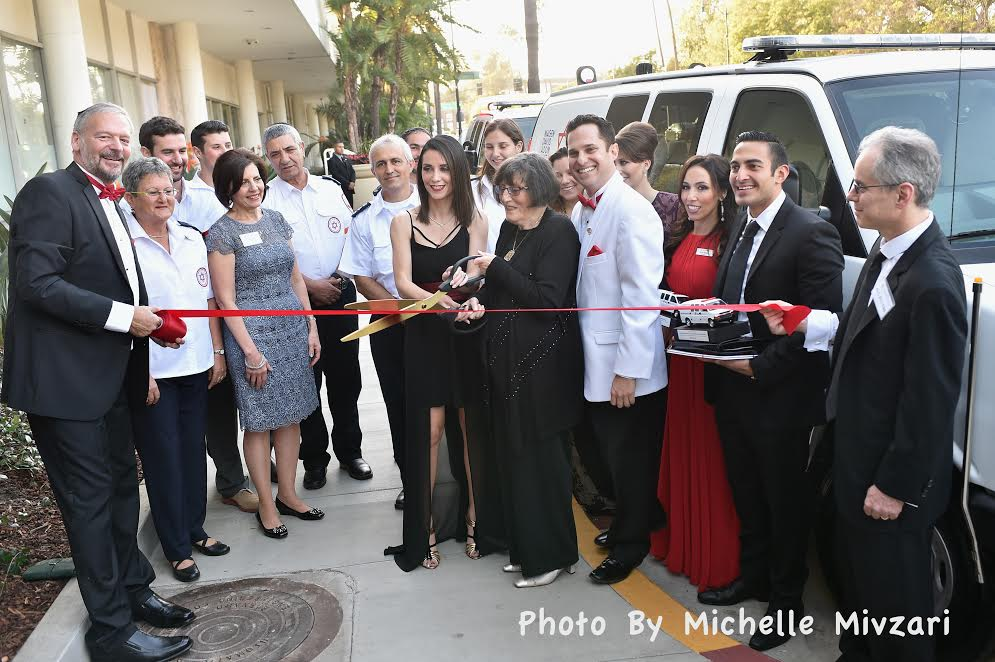 Before the gala, Ambulance Dedication in Beverly Hills. Donor Myrtle Sitowitz cuts the ribbon