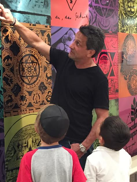 Marc Bennett explains his Magen David art to Sinai Temple pupils