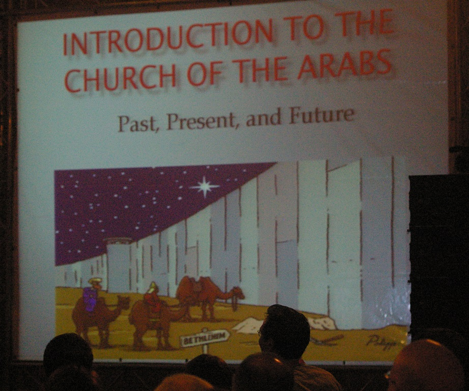 During the 2014 Christ at the Checkpoint Conference, Yohanna Katanacho, Academic Dean for Bethlehem Bible College displayed this cartoon of the Three Wise Men being prevented from visiting the Baby Jesus in Bethlehem by the security barrier Israel built to stop suicide bombers. (Photo: Dexter Van Zile)
