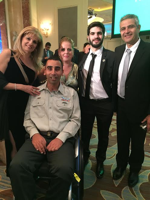 L- Anat Levy, Lieutenant Colonel Shai Siman-Tov, behind him wife Daniela, Adiel Levy, father Uziel-Photo Nurit Greenger