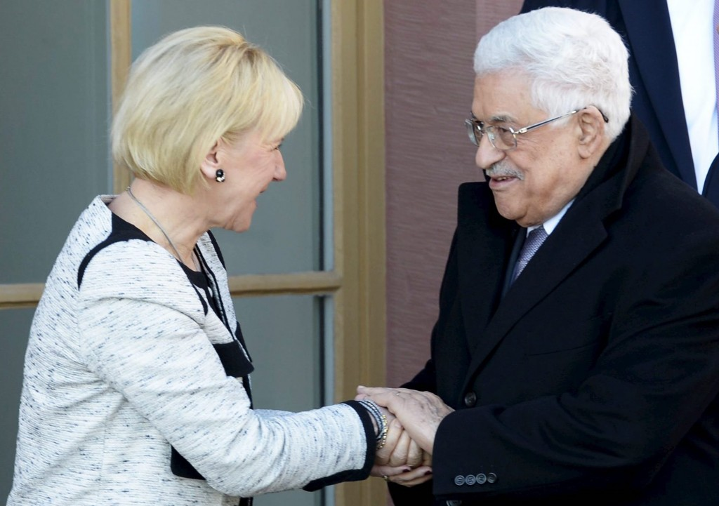Swedish Foreign Minister Margot Wallström with Palestinian leader Mahmoud Abbas during the inauguration of the Embassy of Palestine in central Stockholm on Feb. 10, 2015. (Photo by EPA/Jan-Erik Henriksson)