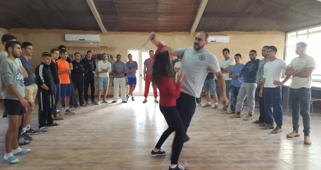 Sensei's Daughter , Sensei Shevy, shows a knife defense technique at full-speed to the chayalim in Yerocham