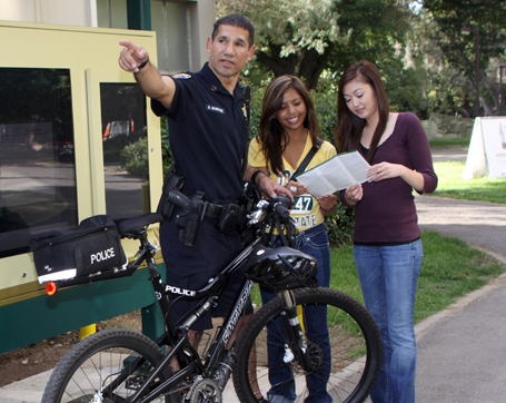 Campus police officer giving directions to students