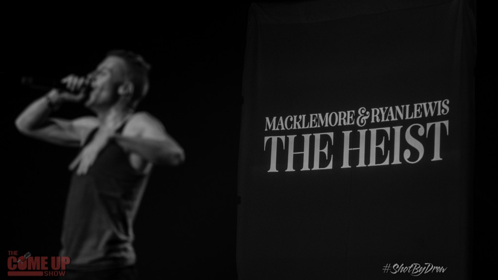 Macklemore performing during his 'The Heist' tour. Ironically, the album would go on to steal the Grammy for Best Rap Album from the Kendrick Lamar's classic Good Kid, M.A.A.D City. (Courtesy of WikiCommons)