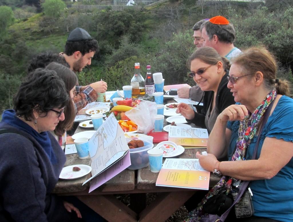 The Movable Minyan celebrating its outdoor Tu b'Shvat seder. (Edmon J. Rodman)