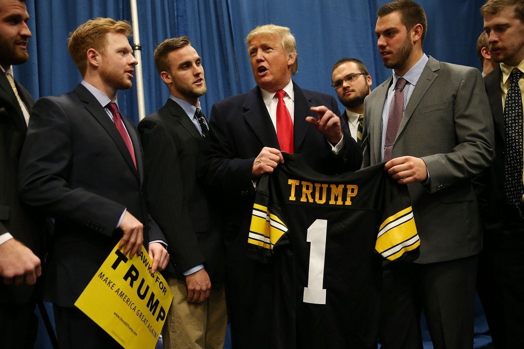 Republican presidential candidate Donald Trump talking with University of Iowa football players at a campaign event in Iowa City, Jan. 26, 2015. (Joe Raedle/Getty Images)