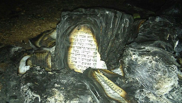 Remains of books of Torah that were burnt in Gush Etzion on Feb 5, 2016 (Photo: courtesy Karmei Tzur Security)