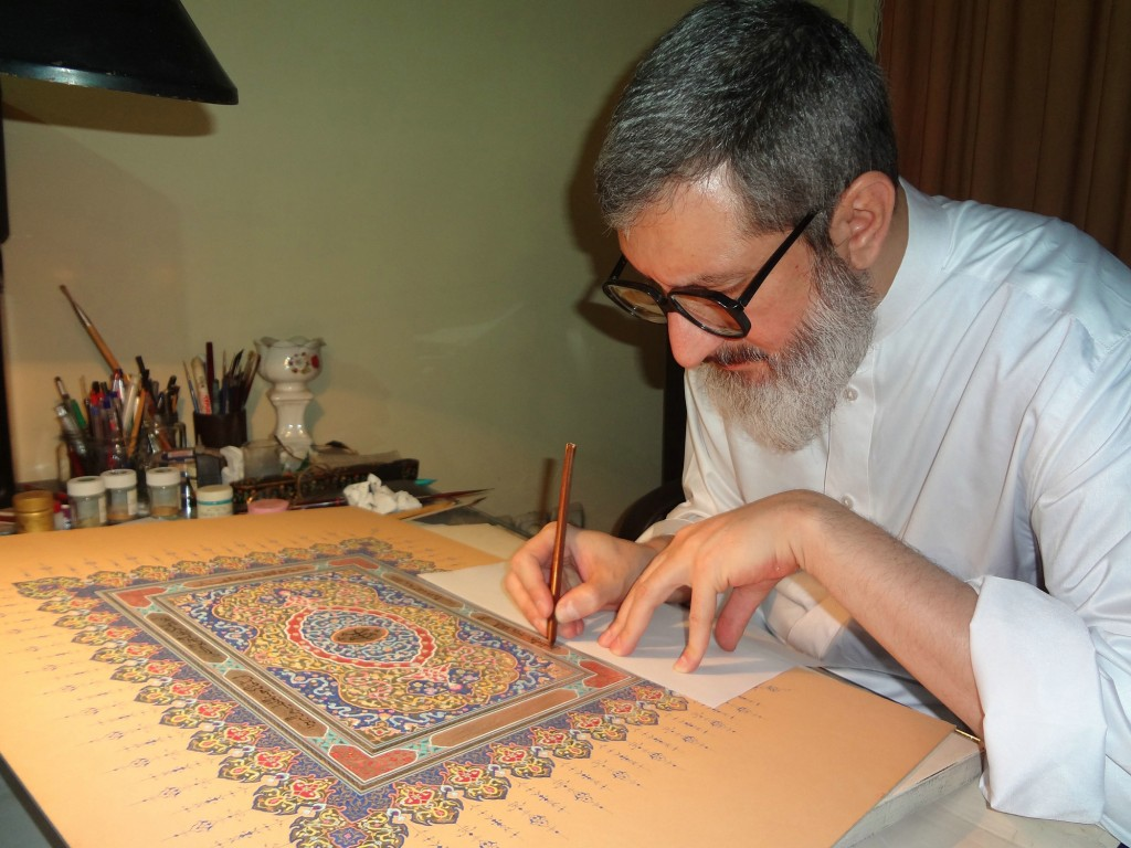 Ayatollah Abdol-Hamid Masoumi-Tehrani perfecting an illuminated work of calligraphy. Image courtesy of the Bahá'í International Community.