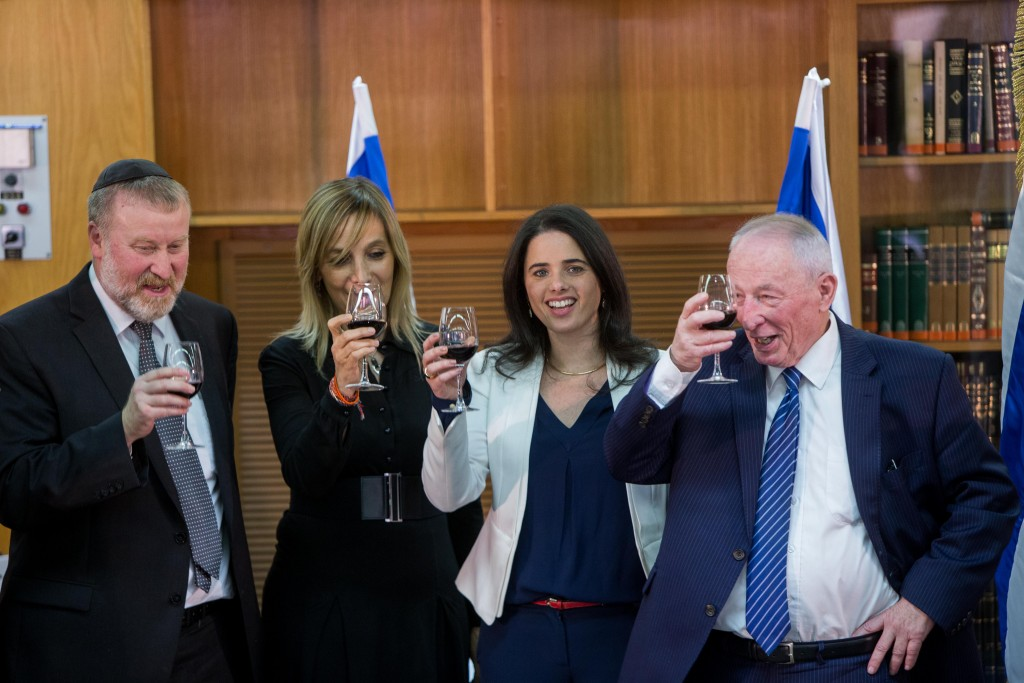 Justice Minister Ayelet Shaked, second from right, has a little drinky with some friends. (Yonatan Sindel/Flash90)