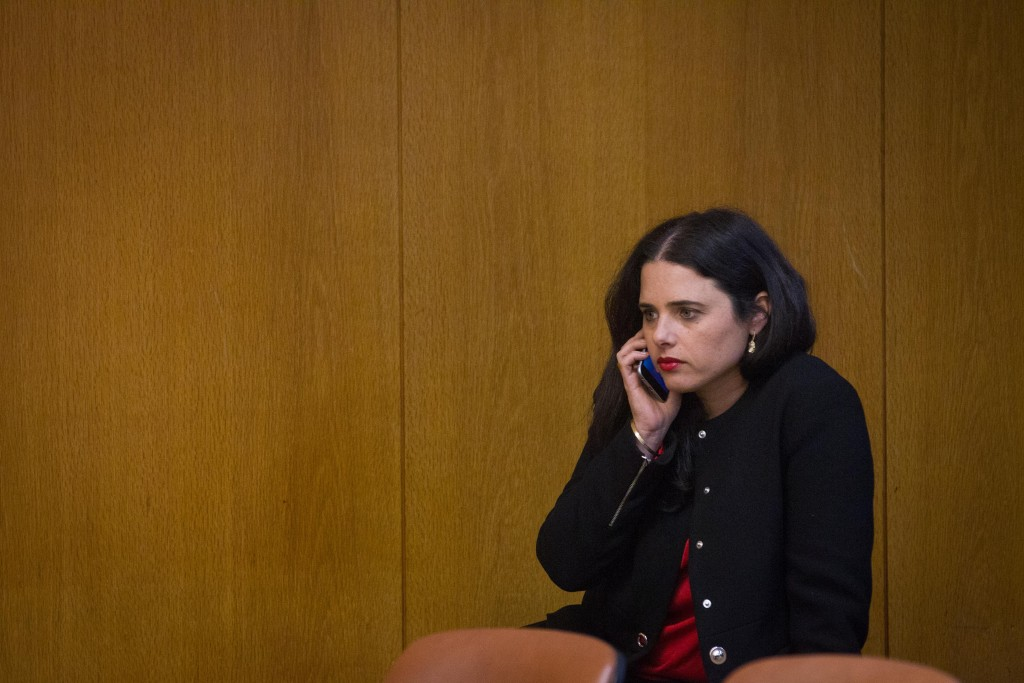 Justice Minister Ayelet Shaked sings 'Happy Birthday to you' to a friend over the phone. (Miriam Alster/Flash90)