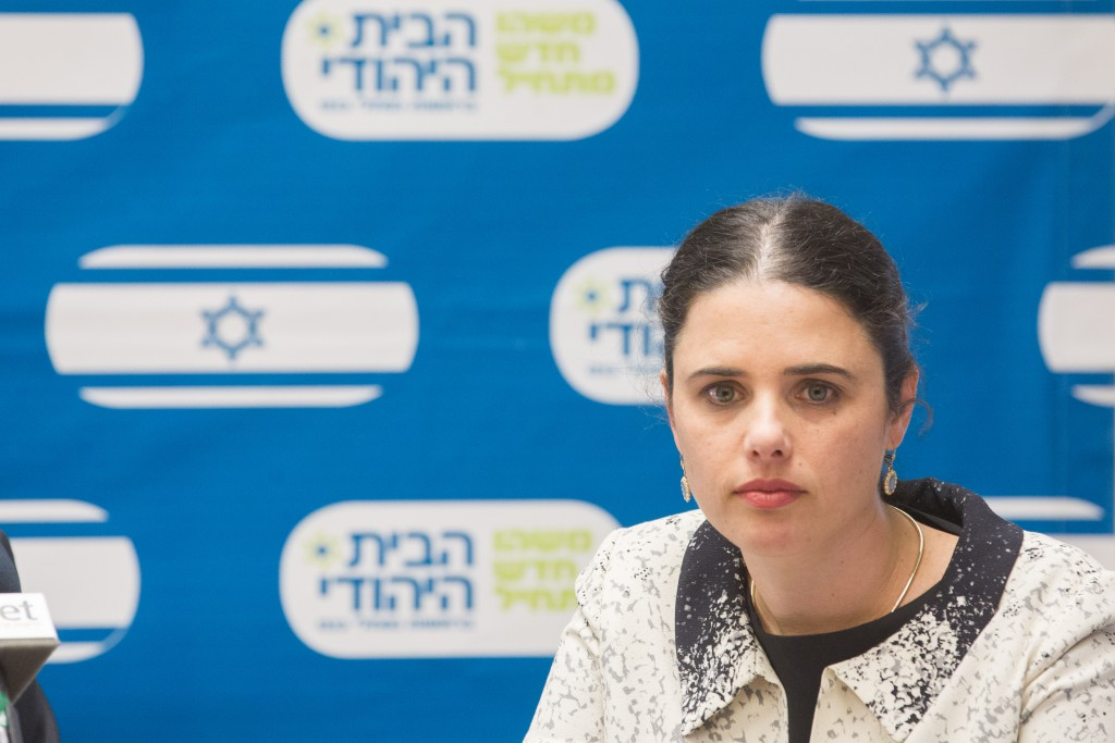 Justice Minister Ayelet Shaked chuckles during a party meeting. ( Miriam Alster/Flash90)