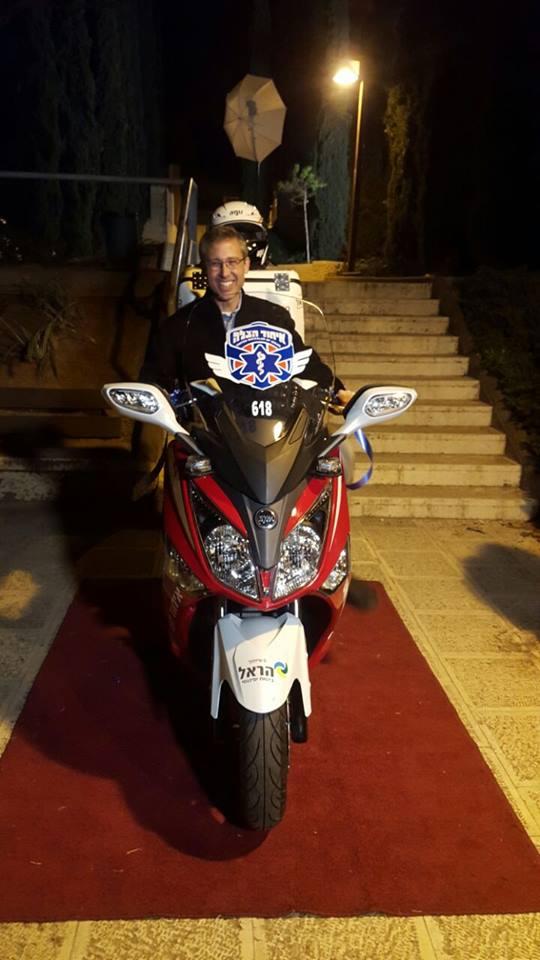 Alan on the ambucycle that his family donated (Credit: United Hatzalah Media Department)