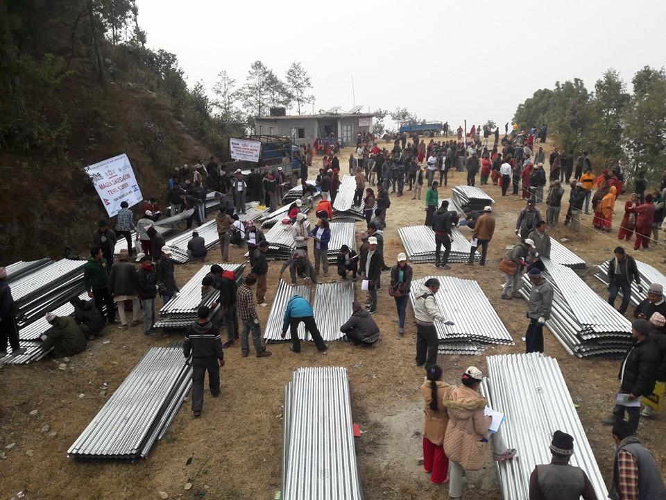 Tin sheeting distribution in Nepali village