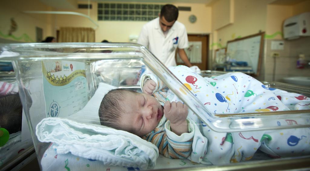 Newborn baby in the obstetrics ward at EMMS Nazareth Hospital, October 31, 2012. (Moshe Shai/FLASH90)