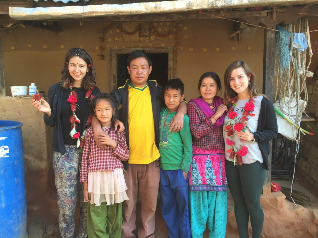 The Tamang family with Israeli volunteers Sarah Kalinsky (on left) and Dana Harel, R, in Manegau. April 2016 (Iddo Gefen)