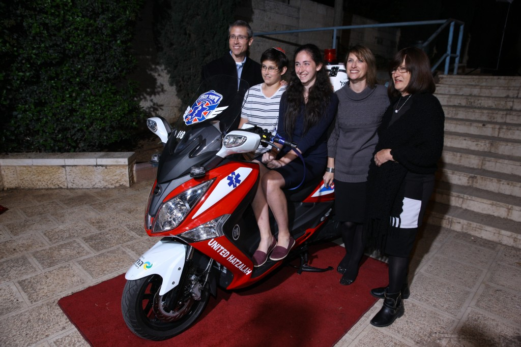 The Tennenberg family and the ambucycle which they donated (Credit: United Hatzalah Media Department)