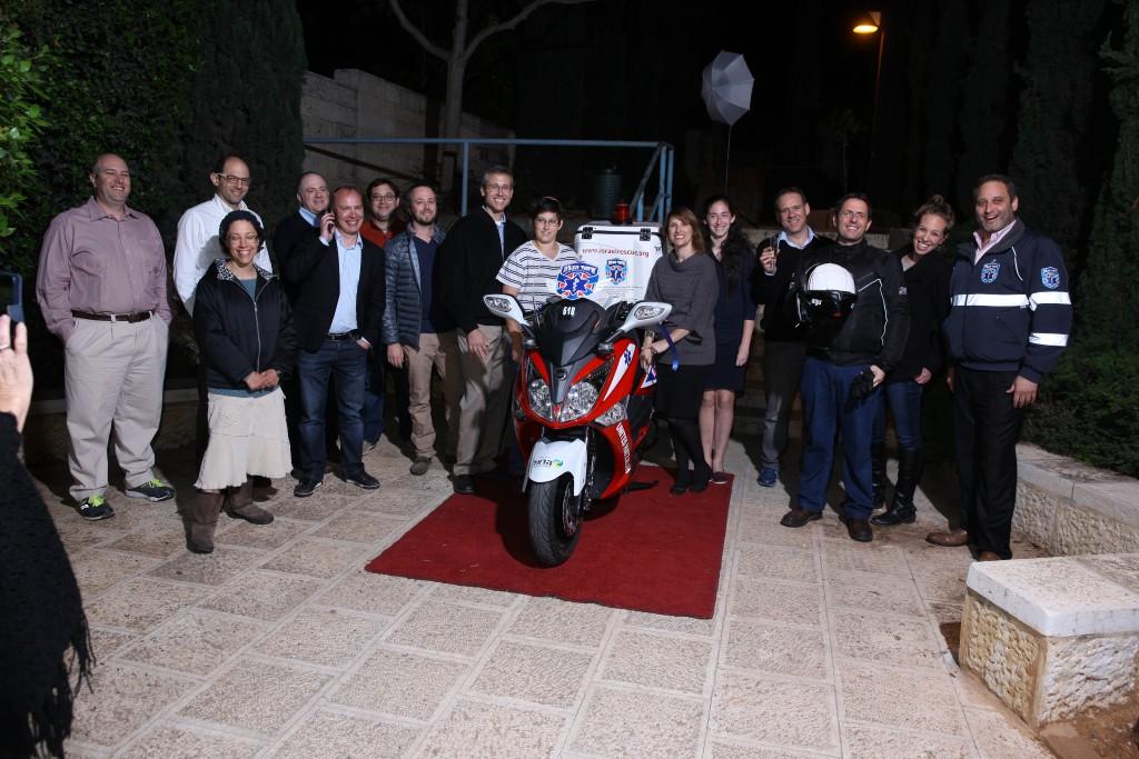 The Tennenbergs with United Hatzalah personnel at the dedication ceremony. (Credit: United Hatzalah media Department)