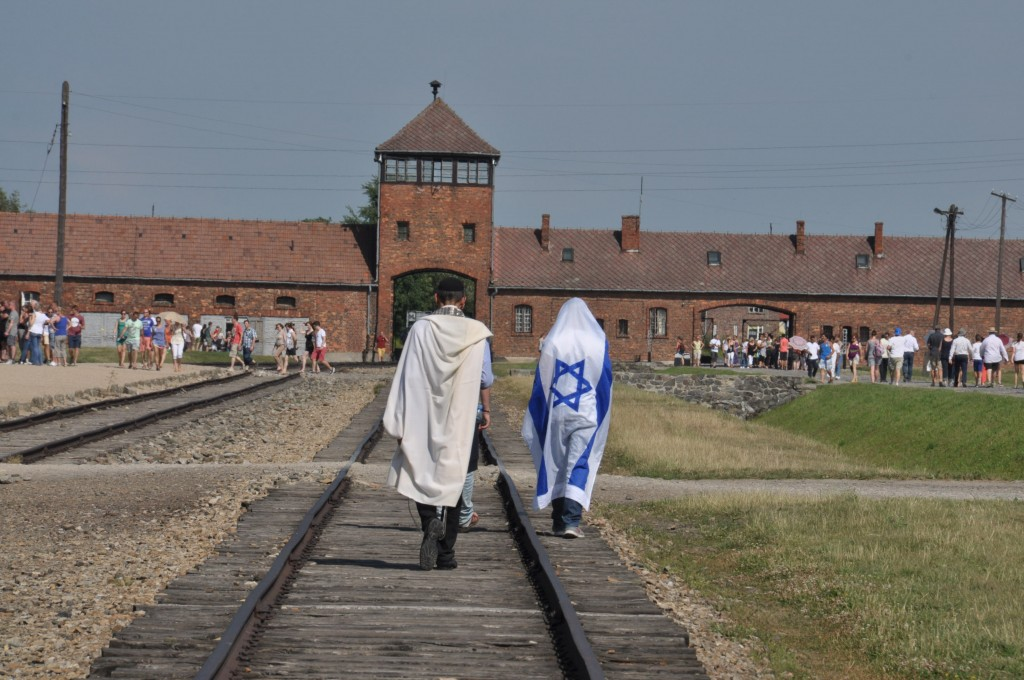 Aushwitz: Mois wearing a Talit in a place where Jews were stripped of theirs.