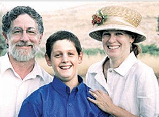 "Koby Mandell z""l with his parents at his Bar MItzvah"