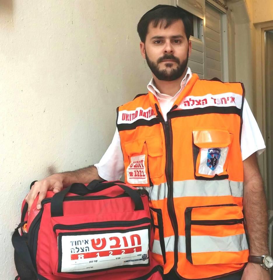 United Hatzalah volunteer EMT Davidi Dahan with his medical kit.