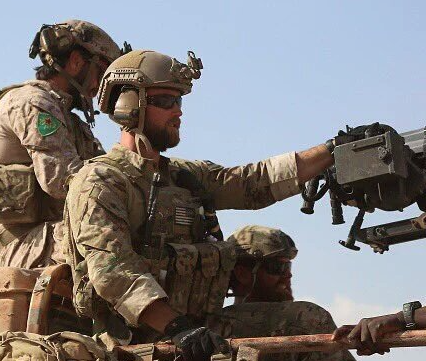 US troops with YPG badges