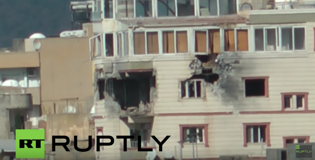 Still from a video of the Turkish bombing of its own city of Nusaybin (RT)