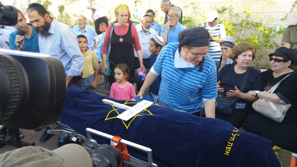 Hallel's mother, Rina Ariel, looks at her daughter for the last time.