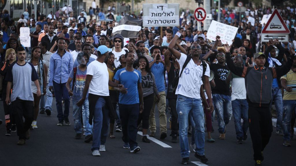 Hundreds of Israeli-Ethiopians protest outside the Police Headquarters in Jerusalem, against violence and racism directed at Israelis of Ethiopian descent, following release of a video clip showing police beating up an IDF soldier from the Ethiopian community. April 30, 2015. (FLASH90/Hadas Parush)