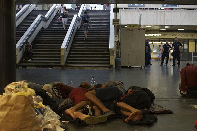 Syrian_refugees_having_rest_at_the_floor_of_Keleti_railway_station._Refugee_crisis._Budapest,_Hungary,_Central_Europe,_3_September_2015