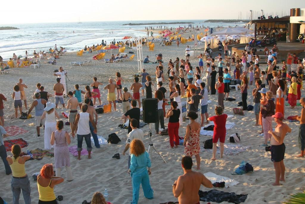 Doing Yoga on Tel Aviv Beach