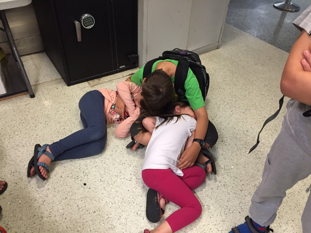 Three of the kids collapsed in a heap on the Philadelphia Airport floor. (Amanda Borschel-Dan)