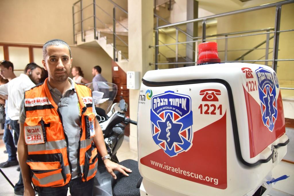Yonatan Avraham pictured with his ambucycle in Jerusalem. (Credit: United Hatzalah)