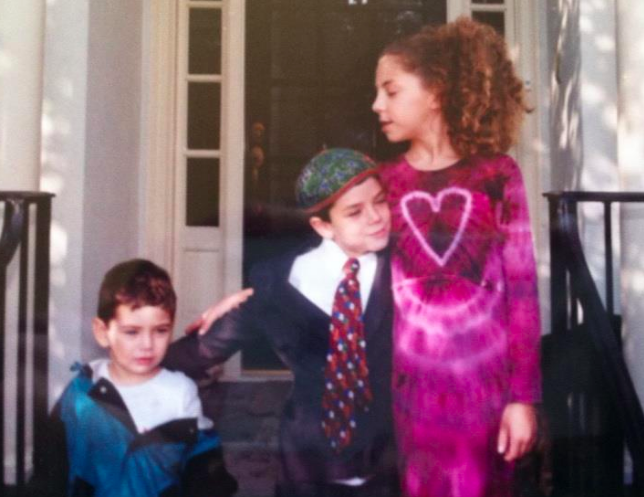 My brothers and I when I had long, bushy curls