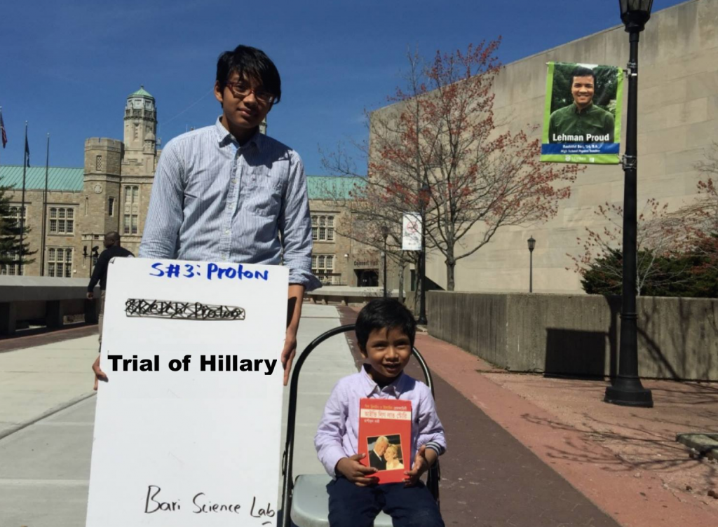 """Albert and Isaac, the author's two sons, are holding book, """"Ivy League Love Story (আইভিলিগ লাভ স্টোরি)"""" on Lehman College's campus."""