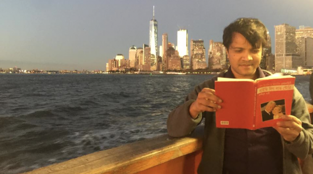 The author is reading his book on Bill and Hillary Clinton, Ivy League Love Story, at the Ferry of the College of Staten Island.