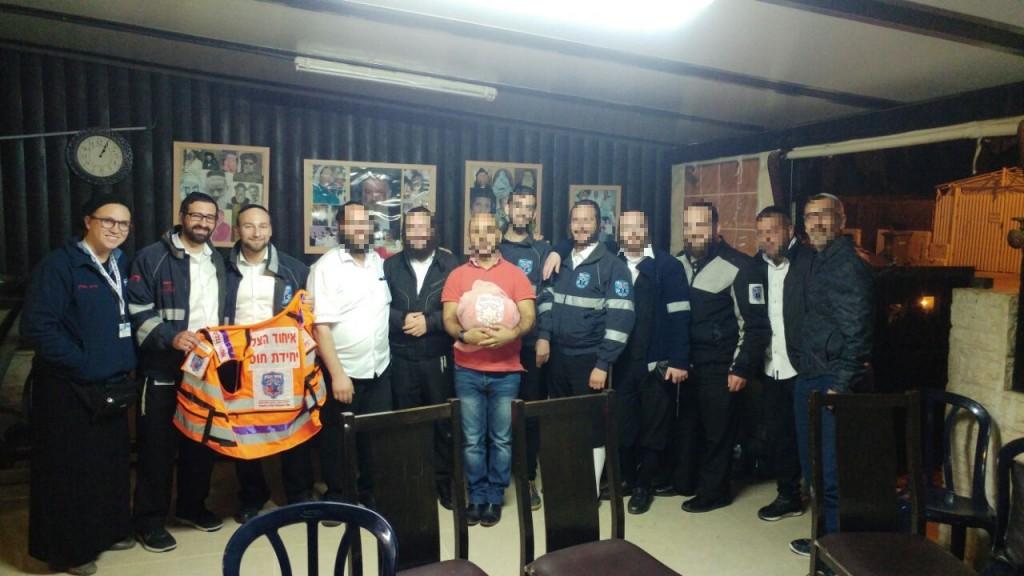 Members of the United Hatzalah Psychotrauma Unit provide support for EMS personnel at group debrief on Saturday night. Credit: Davidi Overlander/United Hatzalah