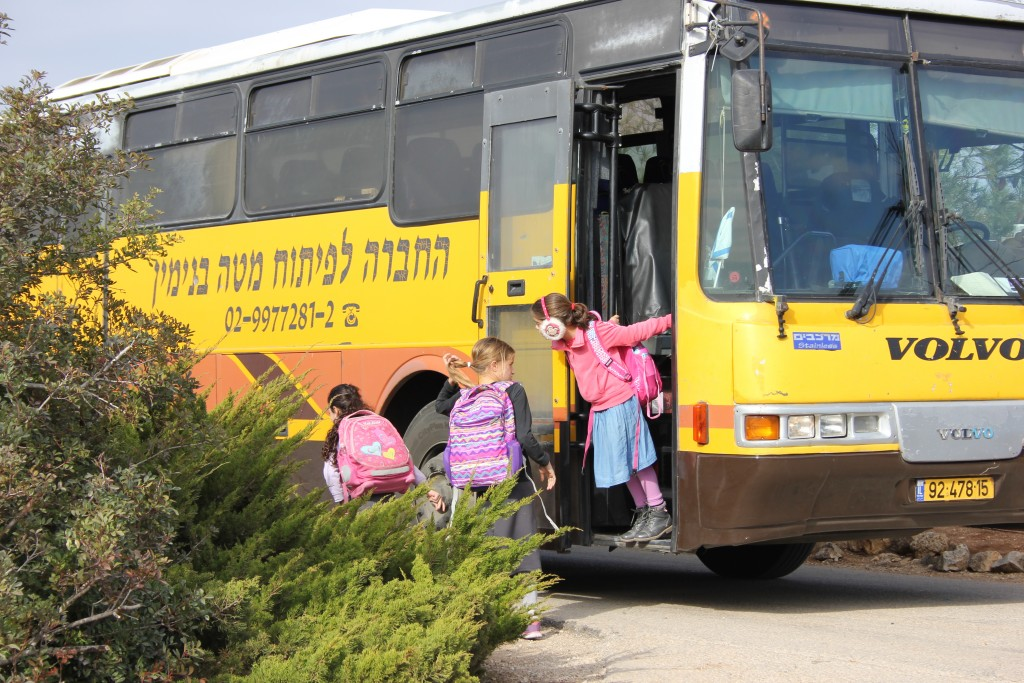 Busloads of Amona children come home from school