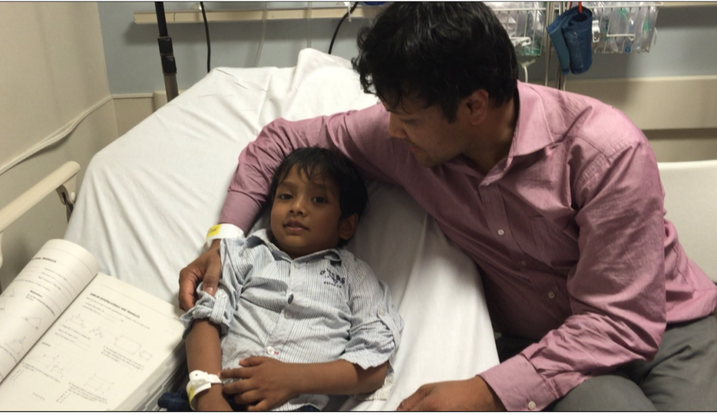 """Two-year-old Isaac was lying on a hospital bed, suffering from a fever. I (Rashidul Bari) was sitting on the chair next to his bed. I held his hand and said, """"Don't worry, Isaac. You'll be fine soon because Daddy love you more than anything in the universe."""""""