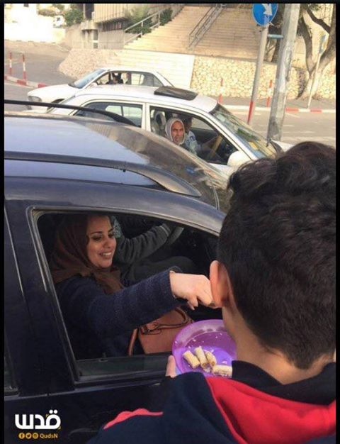 PURE EVIL: Palestinians pass out sweets to celebrate truck attack in Jerusalem that killed 4 people. Photo: