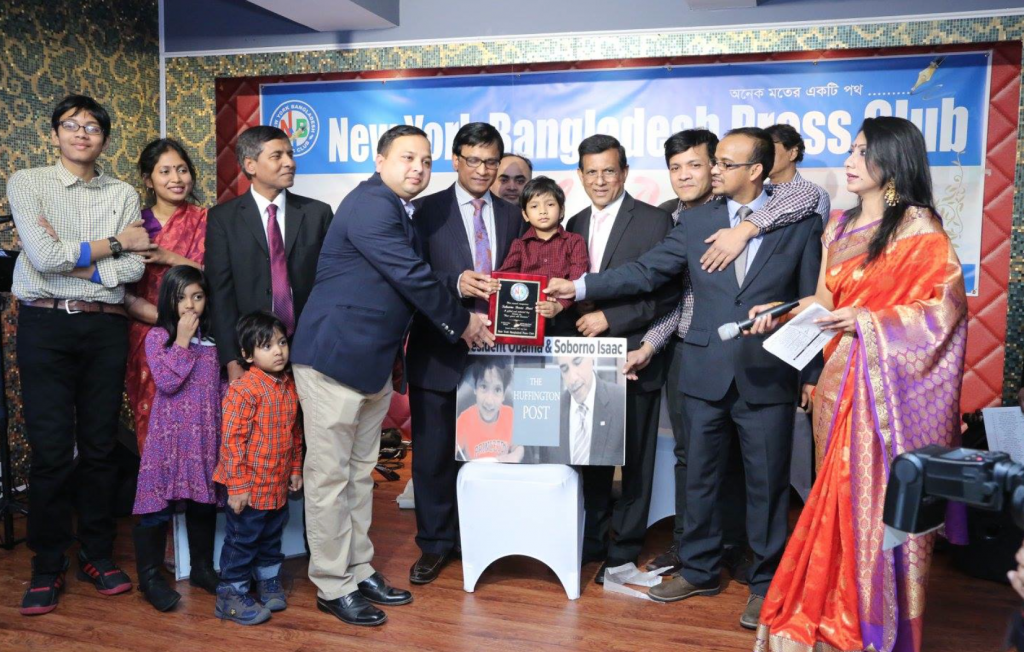 """On behalf of all the Bengalis in the world, Dr. Wazed A. Khan, editor of the Weekly Bangladesh, and Kayes gave Bari the """"4 Year-old Einstein"""" award."""