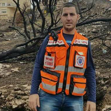 Mordechai Ben Ezra volunteers as an EMT and works for the city of Kiryat Ata with the police force.