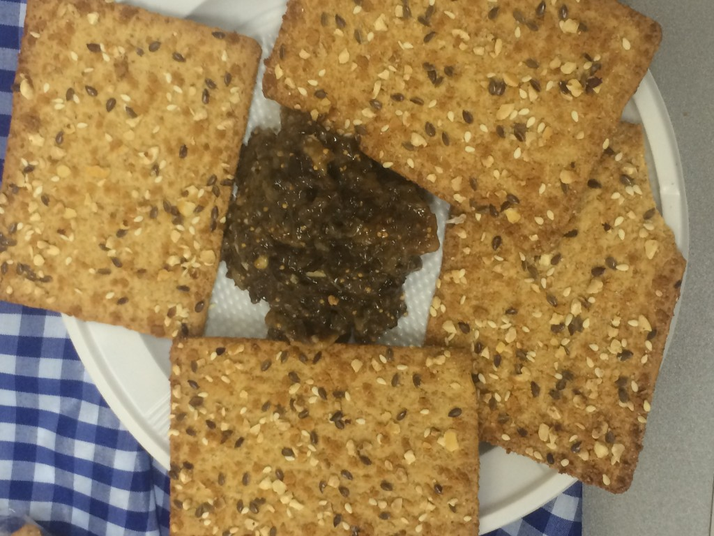 Olive and fig dip with seven grant wheat crackers.