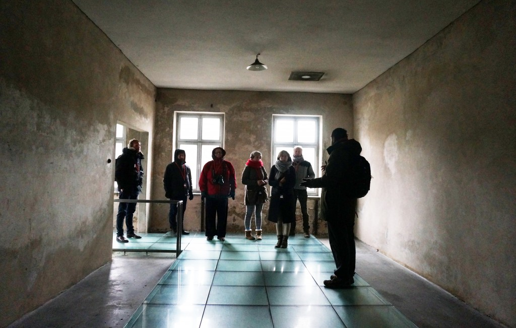 Journalists and a spokesman for the Auschwitz museum visiting a former disinfection facility, Dec. 1, 2016. (Cnaan Liphshiz)