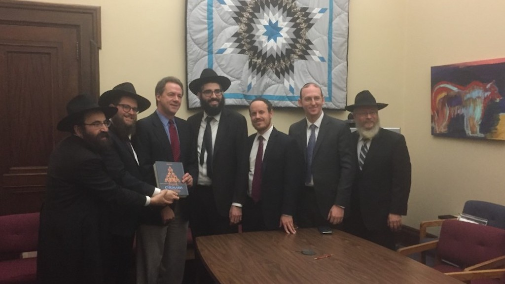 A delegation of rabbis presenting a Chumash to Montana's Governor Steve Bullock